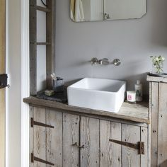Washing machine ? Cupboard, washed wood and basin