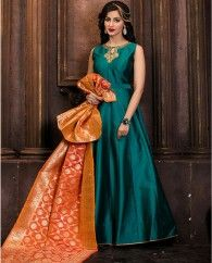 1. Teal Green silk anarkali suit 2. Adorned with jeweled toned necklace embroidery 3. Comes with a matching shantoon bottom and silk dupatta 4. Can be stitched upto bust size 42 inches and top length 50 inches