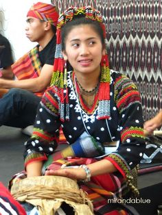 T'boli girl playing a tnonggong, a deerskin drum used as a supportive instrument in the kulintang ensemble. The T'boli is an indigenous tribe from the highlands near Lake Sebu, South Cotabato in Mindanao. They have a rich heritage in music, dance and story-telling. Mindanao is the second largest and southernmost island in the Philippines.