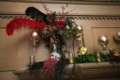 Masquerade Holiday Party in The Lodge at The Regency Center like no other...Aerialists, Opera singers, #feathers, #masks and bejeweled florals abound!  Mantle decor : #hydrangea #berries #orchids #mercuryglass  Photographer: Gustavo Fernández Photographer  Florals: Soulflower Design Studio, come visit us at http://soulflowersf.com/