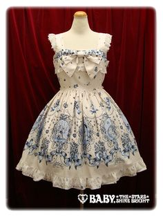 "love this...""cinderella"" themed vintage dress LOVE it...love the color and the style..and wish I lived in the 40s and 50s...I love the style of those times"