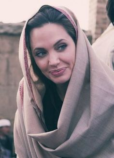 faineemae:    um-er:    Woman in Peshawar.    That's not any woman, that's Angelina Jolie.