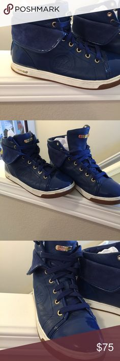 MK Blue leather suede high tops 9 Awesome blue suede shoes high top They are super comfy  Fits a 9.5 too Probably 8.5-9.5 I love The Blue color Only minor wear Michael Kors Shoes Athletic Shoes
