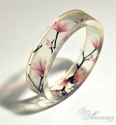 Spring - clear resin bangle featuring lovely Japanese Magnolia blossoms.