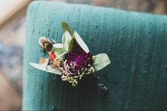 Boutonnière with dahlia and feathers