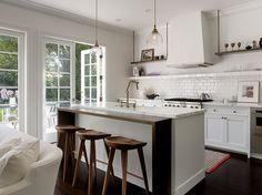 modern/traditional with no upper cabinets. love it.  Palo Alto remodel - Kathleen Bost Architecture + Design