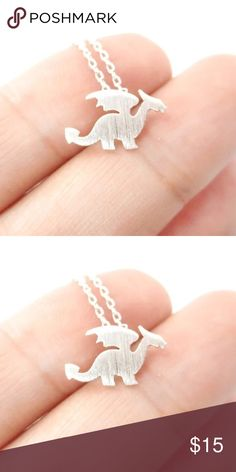 • SALE • Cute Silver Dragon Necklace • ITEM DETAILS: • Silver Toned • Made of copper • Nickel and lead free  DISCOUNT: • On bundles • 30% off for return customers  SHIPPING: • The next day  NOTE: • Color may be slightly different from the actual item due to the lighting • Reasonable offers welcome Jewelry Necklaces