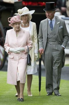 daylife:  Britain's Queen Elizabeth II, with Prince Charles and his wife with Camilla, Duchess of Cornwall walk in the parade ring on the first day of the Royal Ascot horse race meeting in Ascot, England, Tuesday, June 18, 2013.