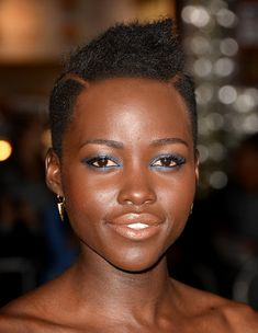 To play up a jewel-toned eye like Lupita Nyong'o's, muted yet shimmering lips are key.