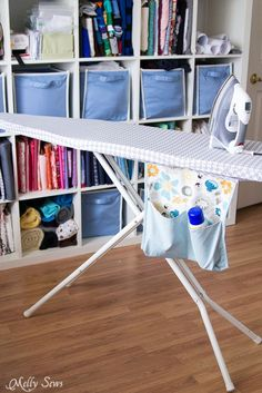 Tutorial for an ironing board cover that fits tightly to the board with a built in storage pocket for starch and spray bottles.