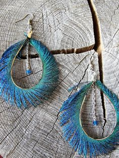 Items similar to Peacock Feather Earrings ~ Feather Fringe Earrings ~ Long Feather Earrings ~ Peacock Sword Earrings ~ Peacock Feather Jewelry on Etsy Feather Jewelry, Feather Earrings, Wire Jewelry, Jewelery, Jewelry Necklaces, Etsy Jewelry, Peacock Jewelry, Peacock Earrings, Jewellery Box