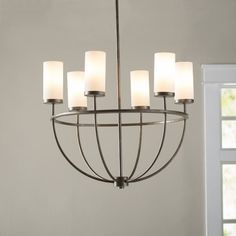 Draw the eye upward with the radiant look of this formal yet fresh chandelier, perfect for accentuating height and adding a sense of drama to your space.
