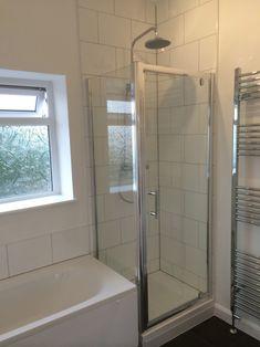Shower Enclosure At End Of Bath in a bathroom installation by UK Bathroom Guru.
