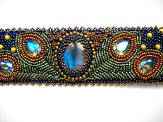 Peacock Bead Embroidery Bracelet Blue Green Bead Embroidered Labradorite Swarovski. $125.00, via Etsy.