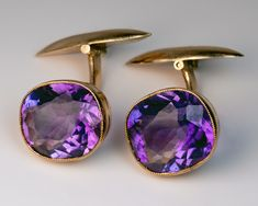 A Pair of Antique Russian Amethyst and Gold Cufflinks, made in Moscow between 1899 and 1908. The 14K gold cufflinks are set with two sparkling bright purple Siberian amethysts (5.62 ct and 5.14 ct).