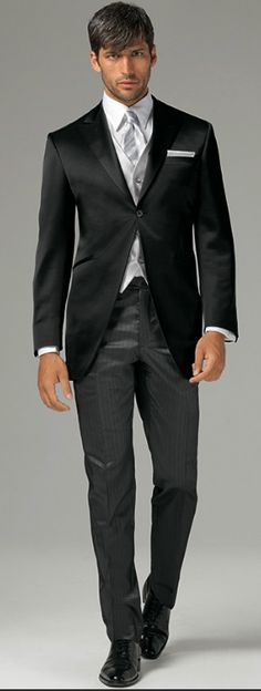 Bride's partner's wedding wear- modern tux with a take on an Edwardian style. Groomsmen will wear complimentary style tuxes.