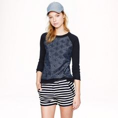 """J Crew eyelet front sweater Adorable light sweater with chambray front with eyelet detail. Front eyelet detail with cream backing. Fabric content tag missing, but feels like a merino wool or similar. 18"""" across bust flat, 21"""" long. Minimal wear. J. Crew Tops"""