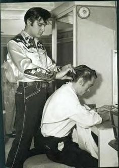Elvis Presley cutting Johnny Cash's hair. 1960