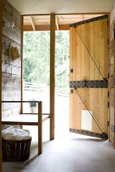 Impressive-Architectural-Design-Decorating-ideas-for-alluring-Entry-Farmhouse-design-ideas-with-barn-door-basket-black-hardware-built-in-cement-floor-hooks-rafters-seat-wall | Best Remodeling and renovation guidesBest Remodeling and renovation guides