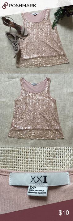 "Ballet pink sequin covered tank top Forever 21 Pink sequin covered tank top from Forever 21. Ballet pink knit tank lining, pink net overlay covered in gold sequins. 15.5"" pit to pit. 23"" shoulder to hem. 21"" across hem. Lining 100% rayon. Shell 100% polyester. ✨Get 20% when you buy 2 or more items✨I will negotiate with ANY offer! Forever 21 Tops Tank Tops"
