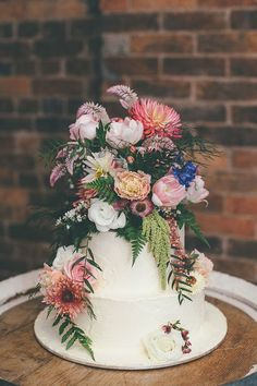 Boho simple 3 tier buttercream wedding cake with flowers
