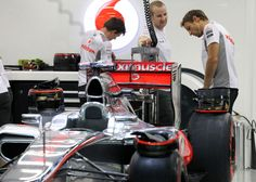 Jenson Button inspects the rear of his McLaren | Formula 1 photos | ESPN F1