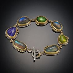 Tanzanite, Labradorite, Green Tourmaline and Vesuvianite Bracelet Ananda Khalsa Jewelry Rose cut labradorite, tanzanite, green tourmaline and vesuvianite are accented with diamond dots. Bracelet measures 7 inches with toggle clasp. Labradorite Jewelry, Gemstone Bracelets, Metal Bracelets, Gemstone Jewelry, Diamond Jewelry, Jewelry Bracelets, Silver Jewelry, Silver Ring, Silver Earrings