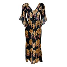 1970's Thea Porter Rose-Garden Floral Print Smocked Silk Bell-Sleeve Dress   From a collection of rare vintage day dresses at https://www.1stdibs.com/fashion/clothing/day-dresses/