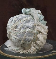 Wonderful french  Valenciennes lace  Bonnet decorated with aqua silk satin ribbons and rosette.  Fully hand stitched,  all original,  in excellent