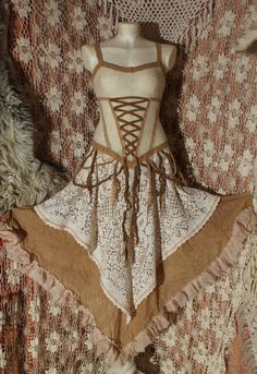 the pirate ghosts wedding dress        offwhite and skin coloured corset lacedress in cotton and lace. €160,00, via Etsy.