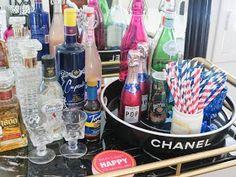 Bar cart. Colored glass bottles.