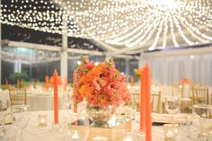 Crisp white Pintuck tablecloths made for a statement base in this colourful styled wedding. The tall orange taper candles, offset with gold mercury tealights, provided an illuminated statement. The beautiful alternating floral arrangements added that pop of sophisticated freshness emphasizing on the vibrant orange water colour texture used for the wedding stationary. The room was complete with our beautiful fairylight canopy. Youtube…