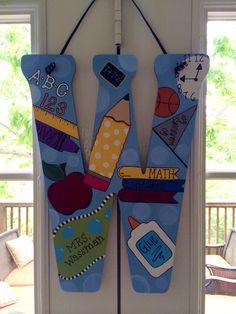 Teacher appreciation gift preschool wood initial door hanger. Teacher Door Hangers, Letter Door Hangers, Initial Door Hanger, Teacher Doors, Teacher Signs, Door Plaques, Wood Initials, Teacher Gift Baskets, Preschool Gifts