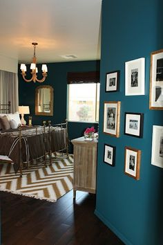 I think I need to do an accent wall like this, with pictures in my master re-design.  LOVE.