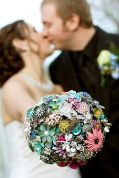 Original DIY Brooch Bouquet Of Artificial Flowers. Have women bring you brooches the day of your bridal shower to make your bouquet. Also use heirloom costume jewelry from women in your family.