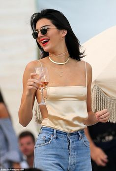 Kendall Jenner wears ERTH 14k gold Tube Necklace       7 RINGS OF FRIENDSHIP CHOKER MOONSTONE CHOOKER HOOP I TUBE NECKLACE  SHOP THE LOOK    FREE SHIPPING ON ORDERS OVER $150 USD