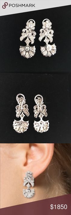 Gorgeous diamond earrings! 14k white gold drop earrings with flower design and omega backs.  1.48 total carat near colorless slightly included round brilliant diamonds.  13.9 grams weight. Jewelry Earrings