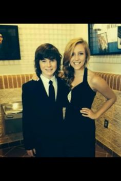 Don't know the girl but chandler riggs looks good