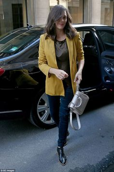 Chic and cheerful: Layering up, the Oscar-winning actress donned a mustard coloured jumper...