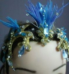 Another unique work of art made by Brazilian artist Eliana Salles. This Blue Bird tiara will complete the look of Princess Florina's tutu. Production timeline: 3 weeks Price: 180.00 + shipping