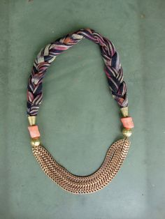 Vintage Ikat fabric. Pink coral. Hammered brass beads. Antique brass chain swags.
