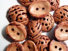handmade buttons from peach pits