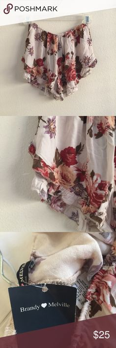Floral Print Vodi Shorts Red floral print cream vodi shorts with elastic waistband and ruffle trim on the edges. Super soft cotton blend fabric. One size fits most from Brandy Melville. New with tags! Not sheer.     🚫Trades 🚫Off posh transactions or 🅿️🅿️ 🚫negotiating in comments  🚷lowballs blocked ✅REASONABLE offers ✅Bundle for 30% off for 3 items or more. Brandy Melville Shorts