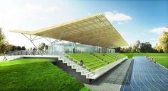 Les tribunes donnent sur le terrain d'honneur qui comprend un terrain en gazon et une piste d'athlétisme. Crédit image: © Barthélémy-Griño architectes