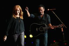 Patti Scialfa (L) and Bruce Springsteen perform onstage at The New York Comedy Festival and The Bob Woodruff Foundation present the 8th Annual Stand Up For Heroes Event at The Theater at Madison Square Garden on November 5, 2014 in New York City.