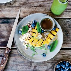 Charred Mangoes with Ricotta, Honey and Caramelized Lime |A simple spiced honey syrup plus ricotta and grilled lime make these mangoes particularly good. In the summer, you can use firm but ripe peaches in place of mangoes. Food & Wine