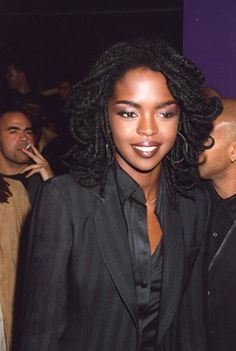 <3     Lauryn Hill  Um, YES, Ms. Lauryn Hill.  This is the feathered look I want to create with my locs!