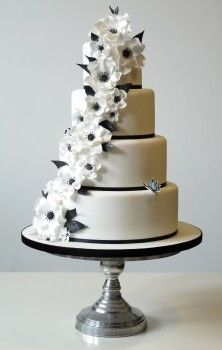Wedding Cake just like this, only square, with green ribbon, and more greenery rather than flowers