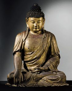 AN IMPORTANT GILT AND RED-LACQUERED WOOD FIGURE OF BUDDHA - CHINA, MING DYNASTY, 16TH CENTURY