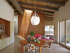 Midcentury Home dining room with vaulted ceiling